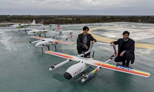 Hammad Jeilani and Christopher Law pictured with their Apian drones.